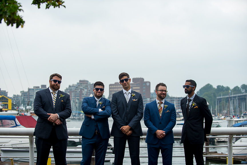 Groomsman on the docks of Vancouver by Meghan Andrews Photography
