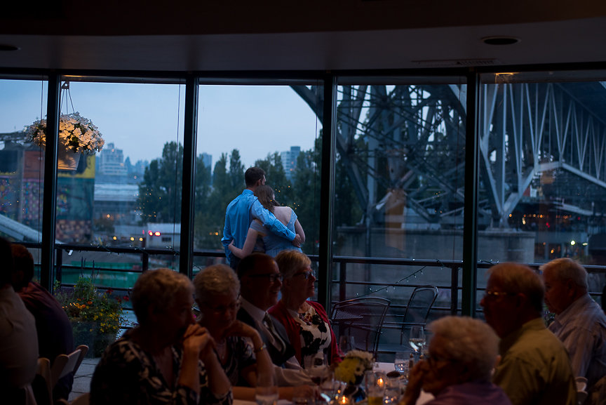 Wedding on the Water guests enjoy the view at False Creek Yacht Club Vancouver
