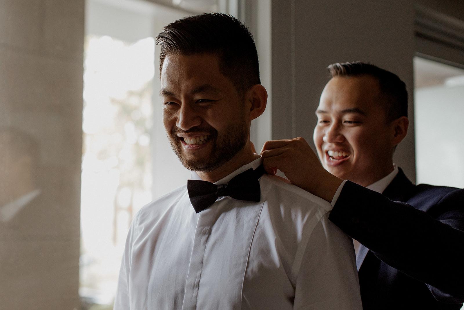UBC Rose Garden Wedding Groom puts on bow tie