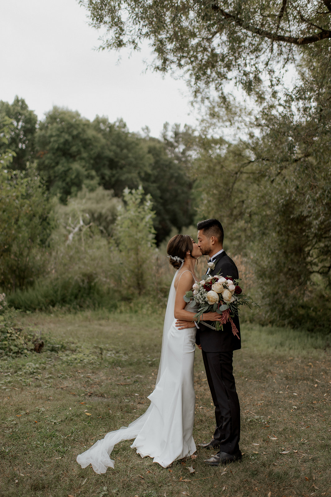 Bride and Groom Kiss at UBC Rose Garden Wedding