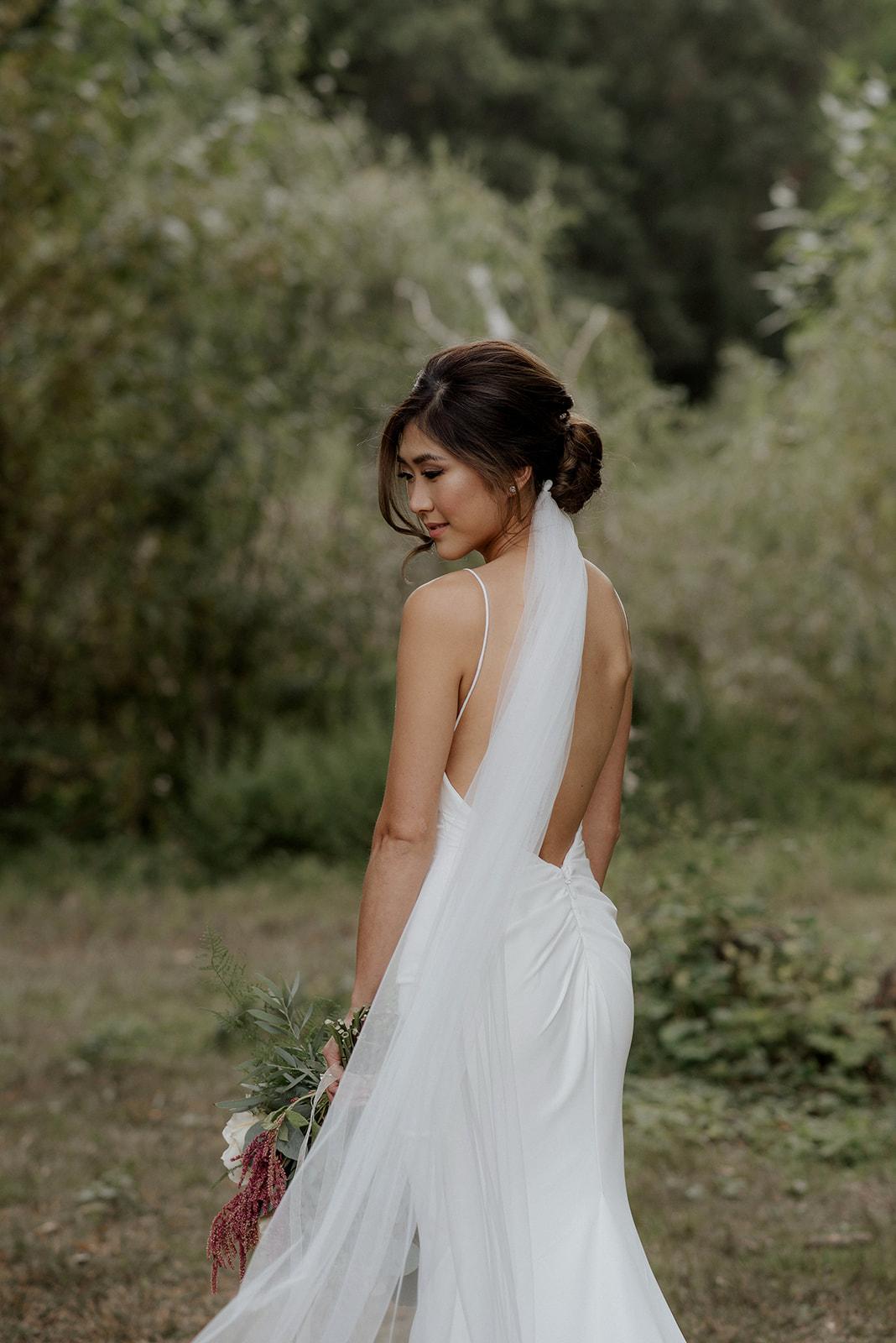 Beautiful Bride in long veil and Hair by Clara Leung