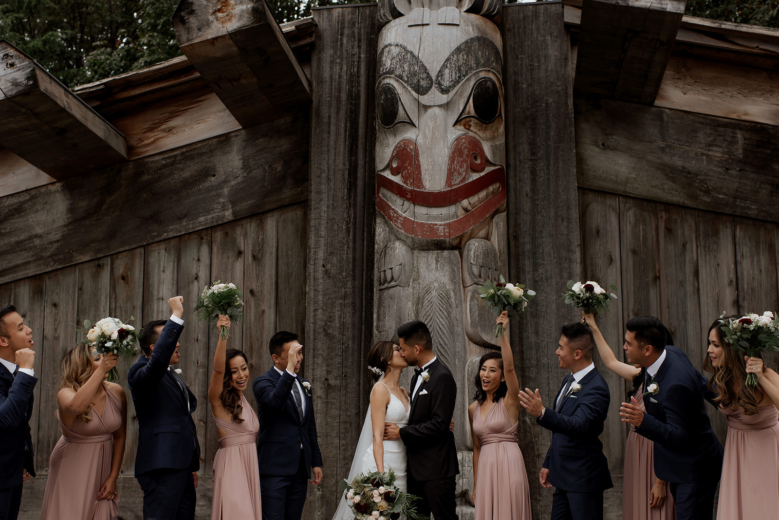UBC Rose Garden Wedding Party in front of Native Indian totem pole
