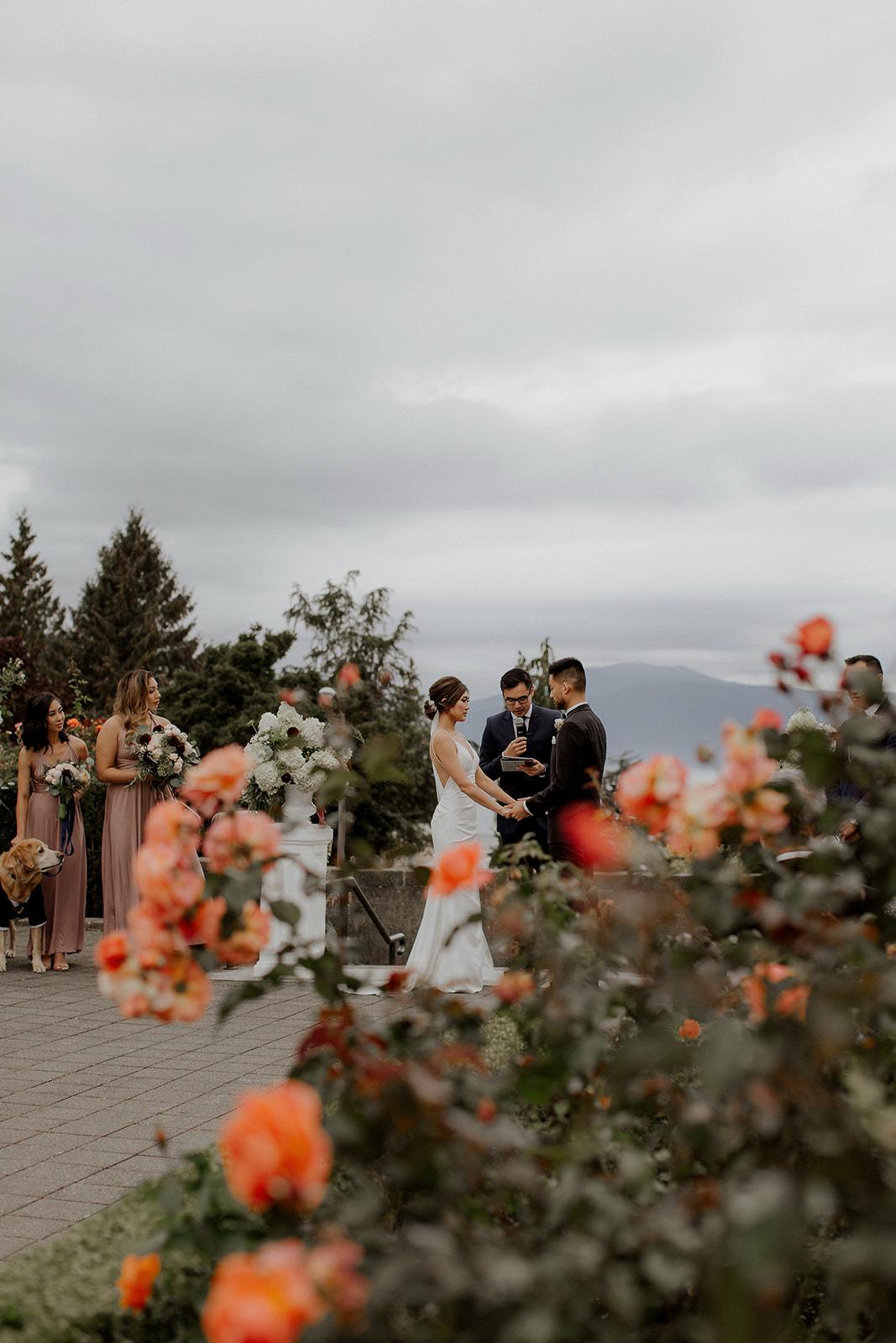 UBC Rose Garden Couple recite wedding vows in Vancouver by Elle Weddings