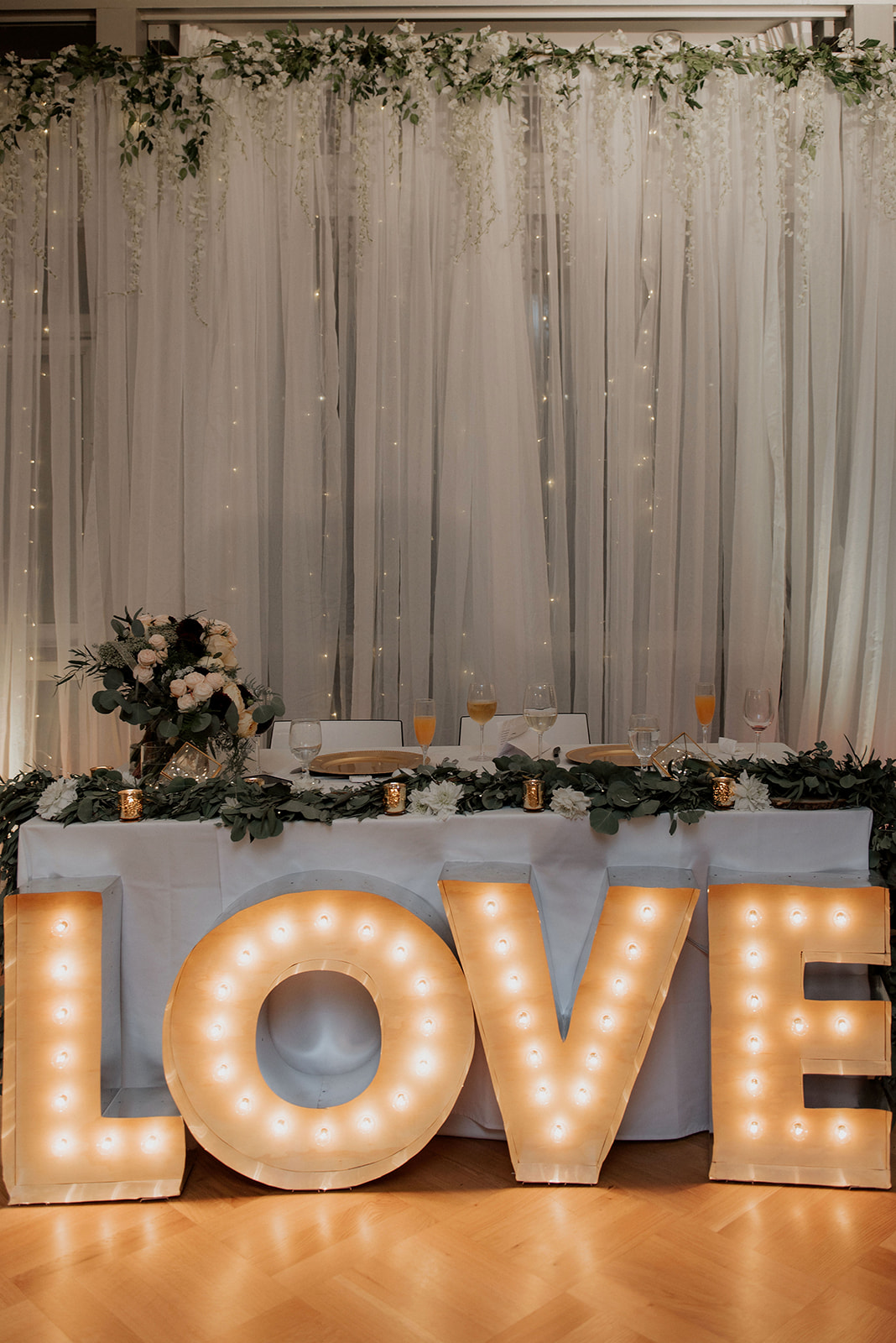 LOVE sign in front of wedding head table in Vancouver