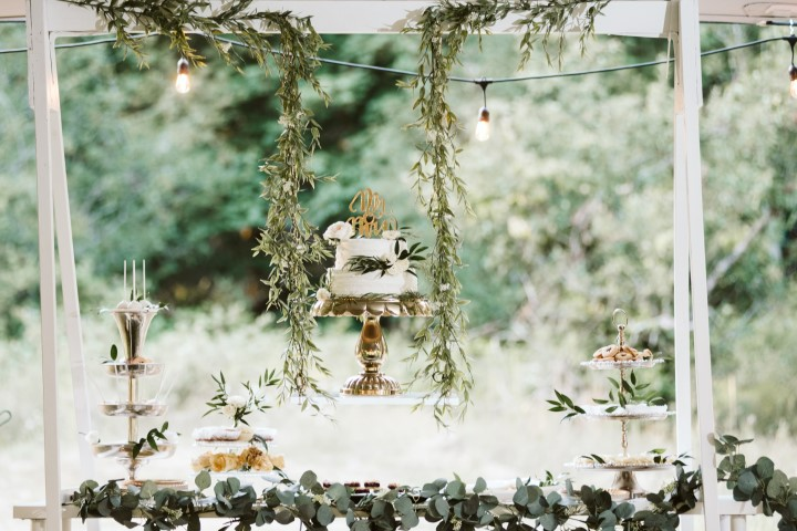 Wedding Cake under greenery by Truffles Catering Vancouver Island