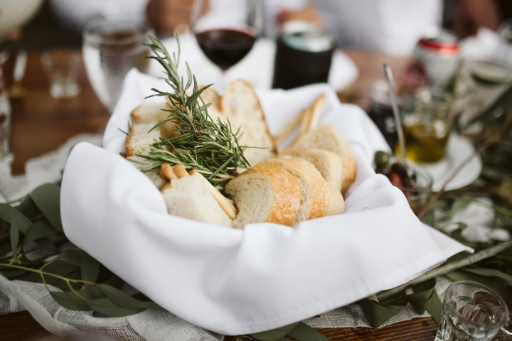 Bread Basket with herbs on wedding reception table by Truffles Catering Vancouver Island
