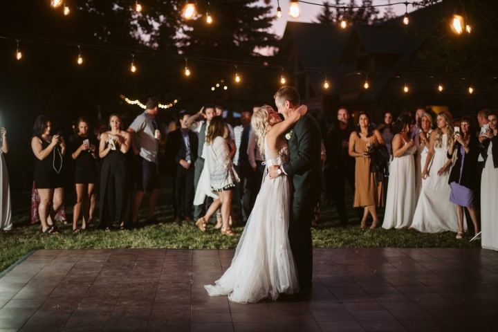 Newlyweds first dance under cafe lights on Vancouver Island
