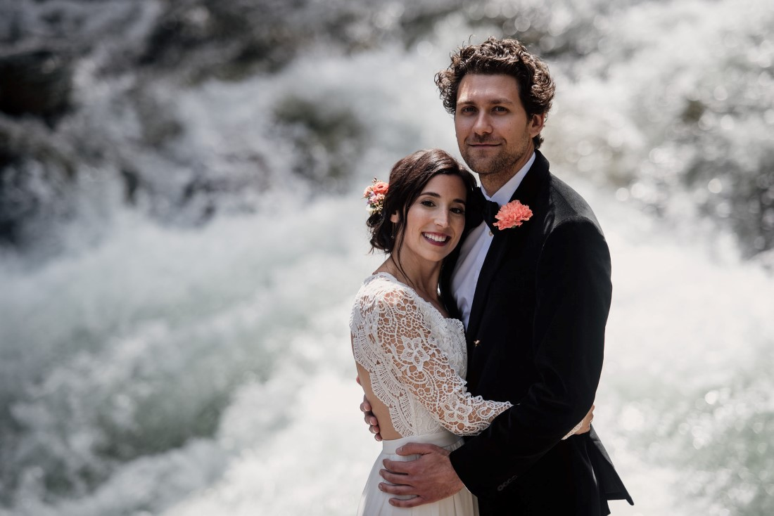 Bride and Groom in front of waterfall near Stone Circle Whistler West Coast Weddings Magazine