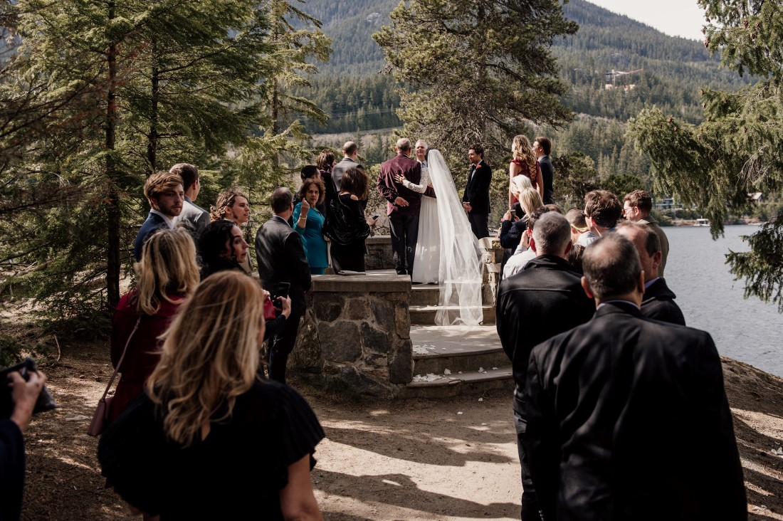 Friends and family surround wedding couple at Stone Circle by Alta Lake BC