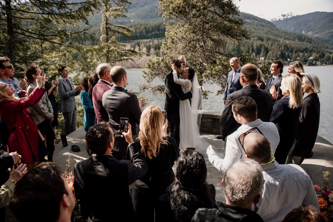 Stone Circle Whistler couple ceremony kiss with Alta Lake behind them