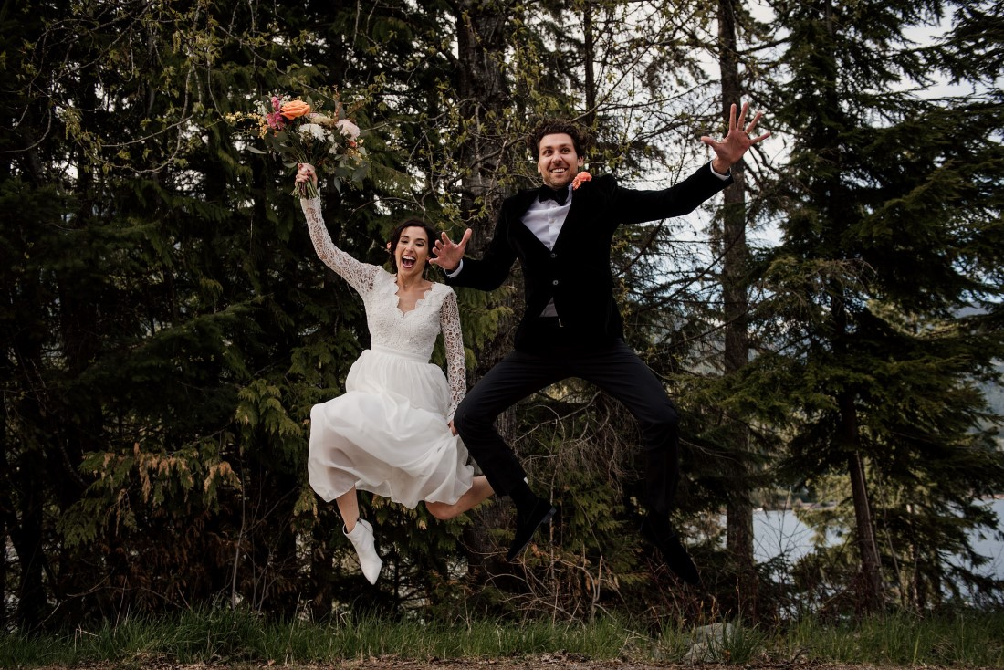 Bride and Groom jump into the air at Stone Circle Whistler by West Coast Weddings Magazine