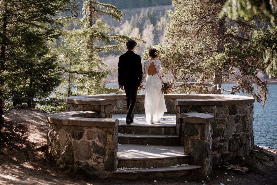 Stone Circle Whistler newlyweds look out at Alta Lake in British Columbia