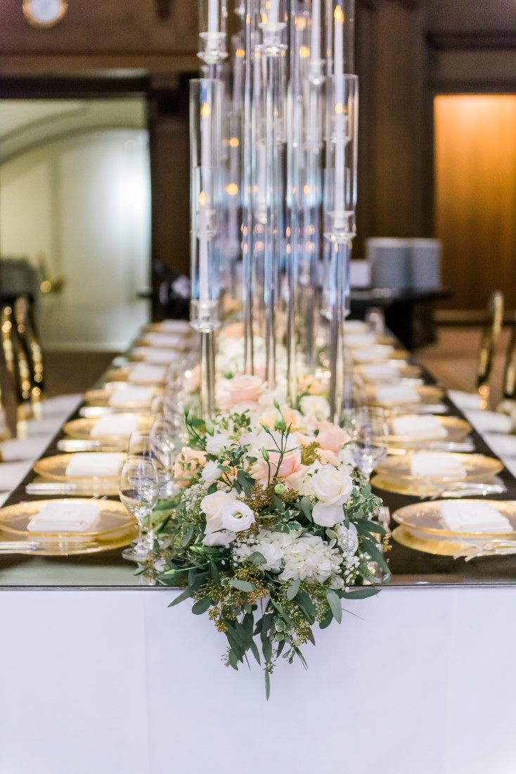 Tall glass vases with white and peach roses on wedding guest table by Elclat Decor Vancouver