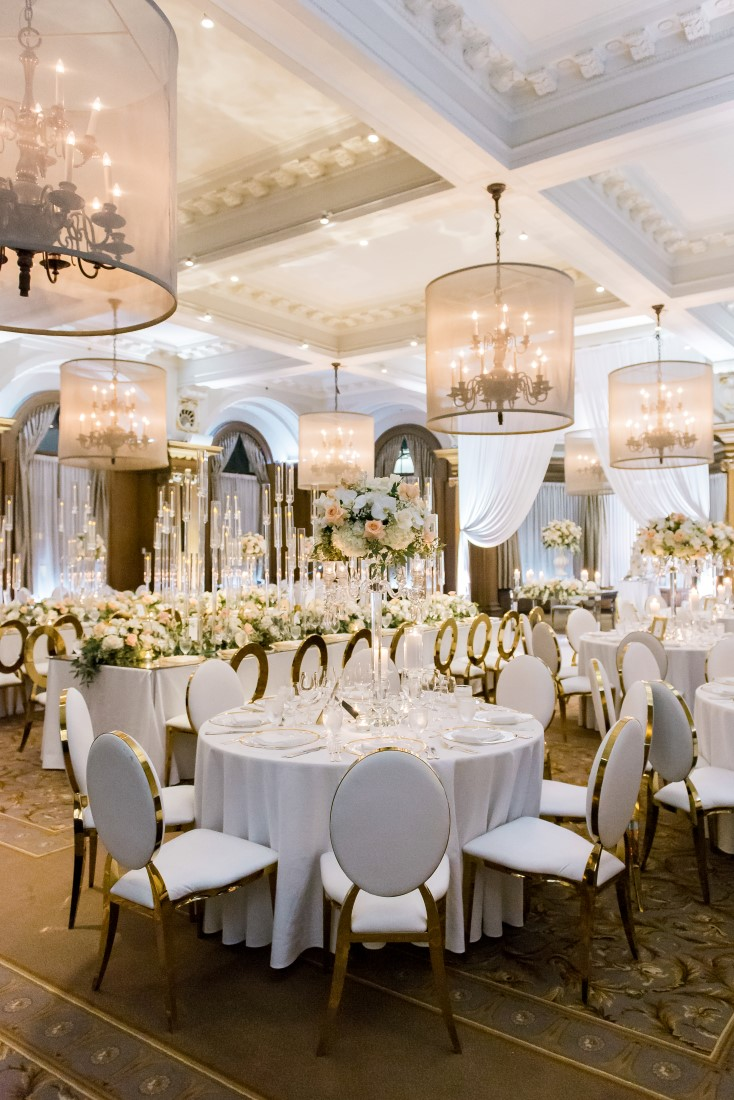 Vancouver Club Ballroom Chandeliers light up peach and white reception by Eclat Decor
