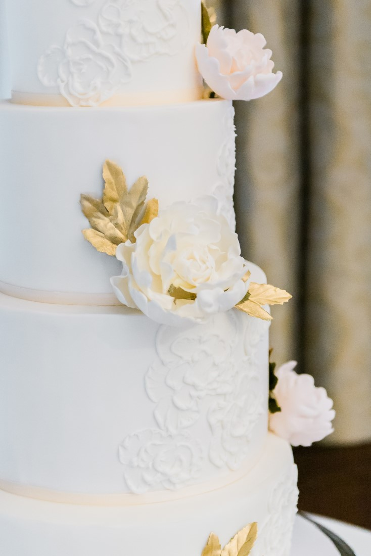 Wedding Cake with peach and white flowers by Neet's Treats Vancouver
