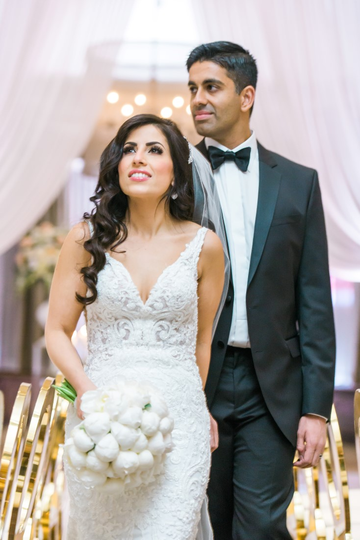 Vancouver Club Wedding Couple walk into their reception by Lestelle Photography