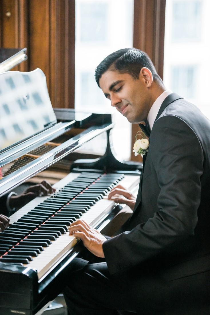 Vancouver Club Wedding Groom playing on grand piano