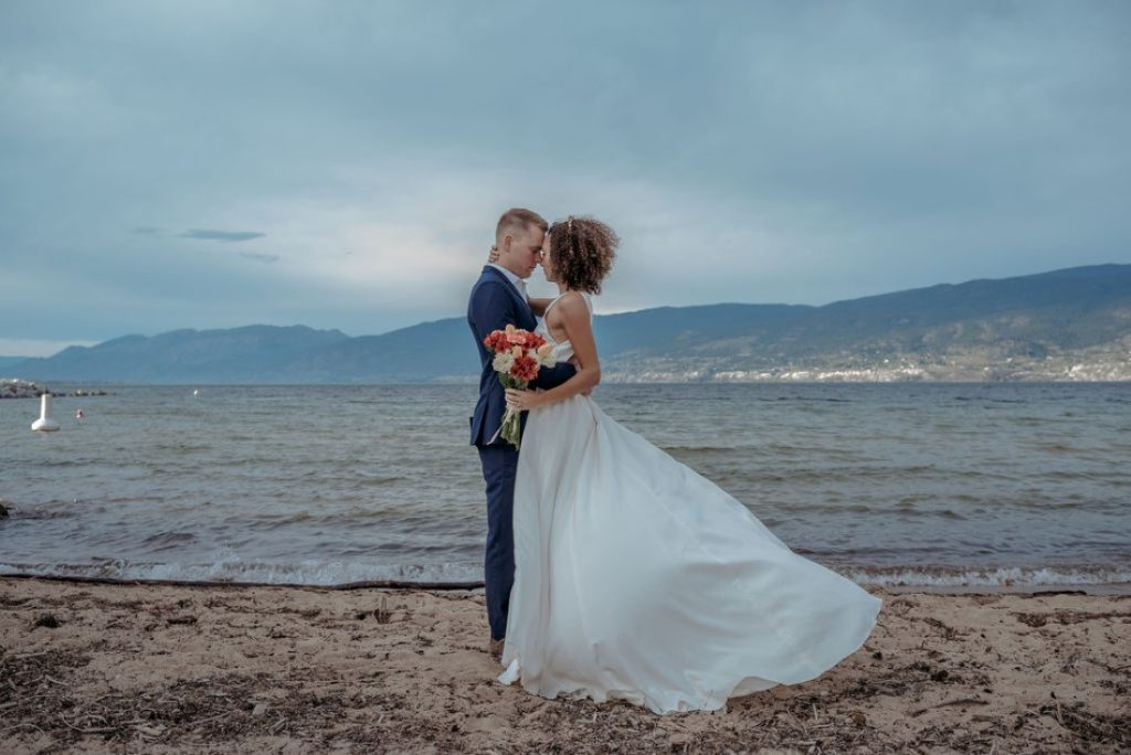 Newlyweds kiss in front of Okanagan Lake