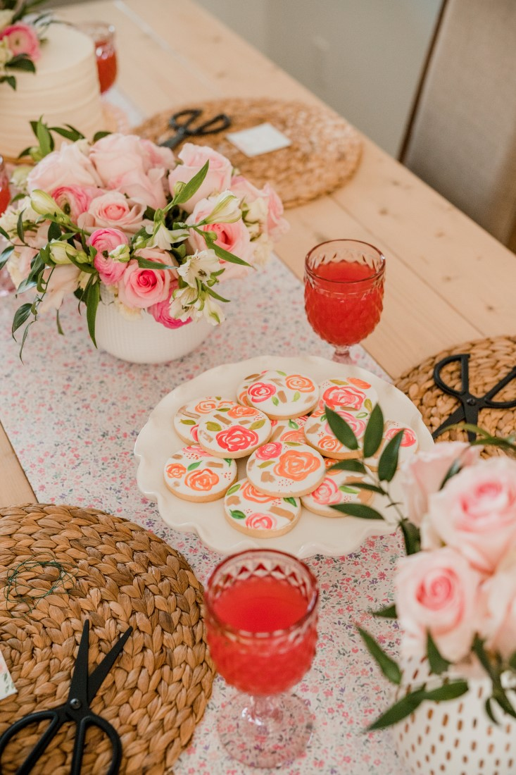 DIY Floral Crown Workshop Bridal Shower table with cookies, wine and flowers