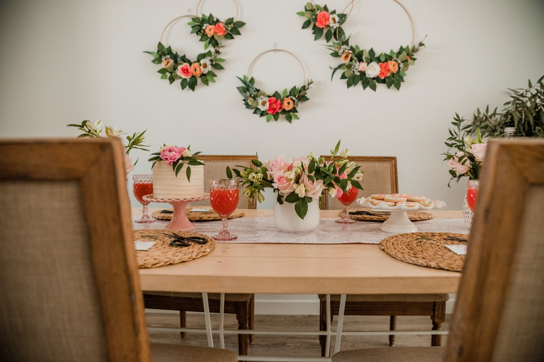 Flower hoops hung on wall as backdrop at bridal shower in Vancouver