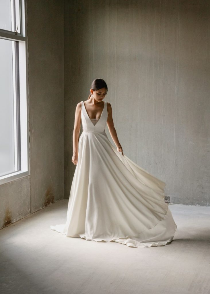 Aesling Crepe wedding dress with a subtle plunge, secured with silk organza.