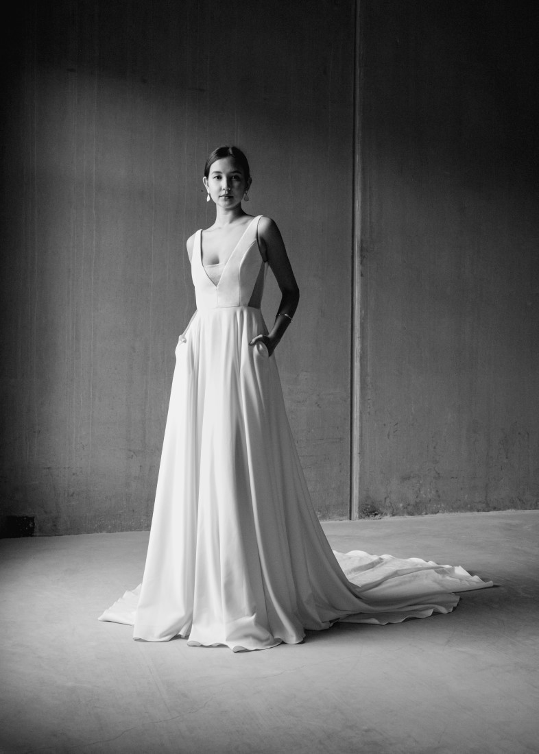 Gorgeous Aesling custom designed gown feature pockets and flowing skirt