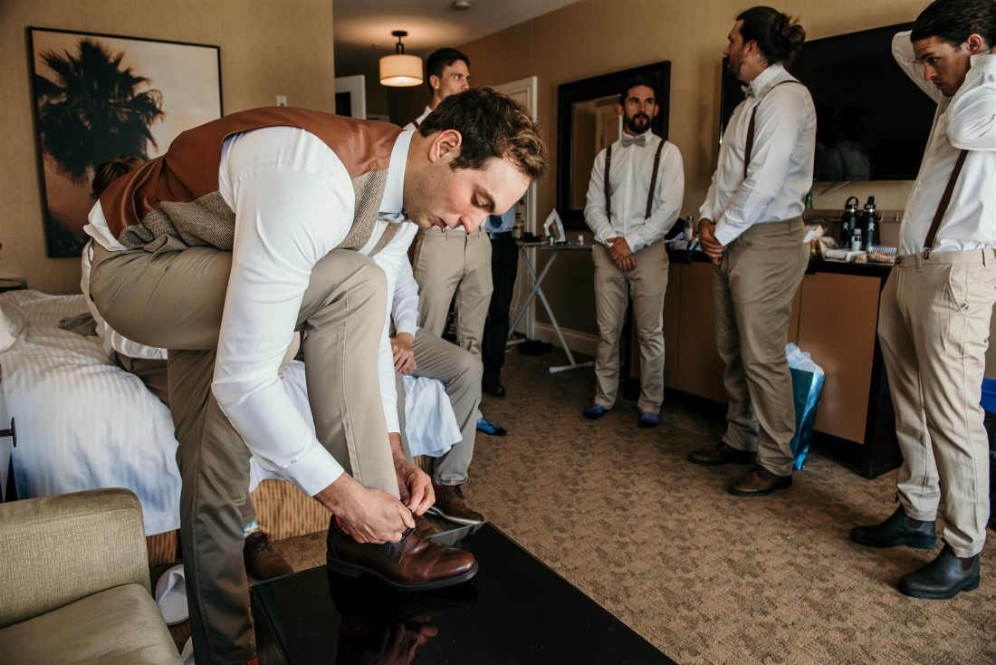 Groom and groomsmen get ready for wedding at Sooke Oceanfront Prestige Hotel on Vancouver Island