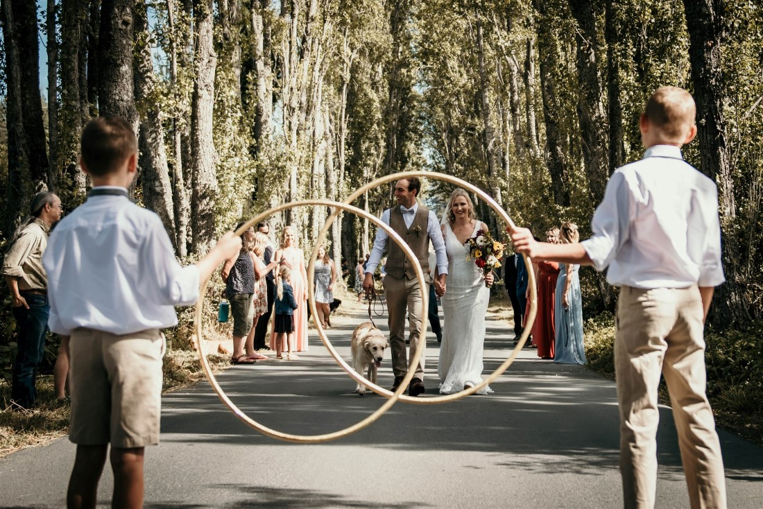 Large hoops in front of bride and groom at outdoor Covid-19 wedding