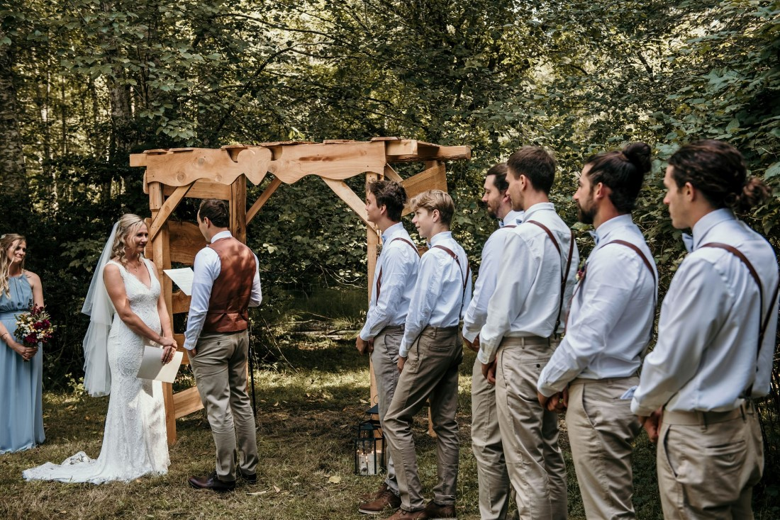 Groomsman watch wedding ceremony on Vancouver Island Farm
