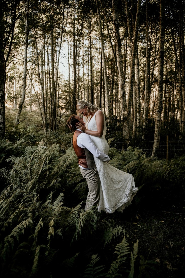 Newlyweds in Vancouver Island forest by Coastline Living Photography