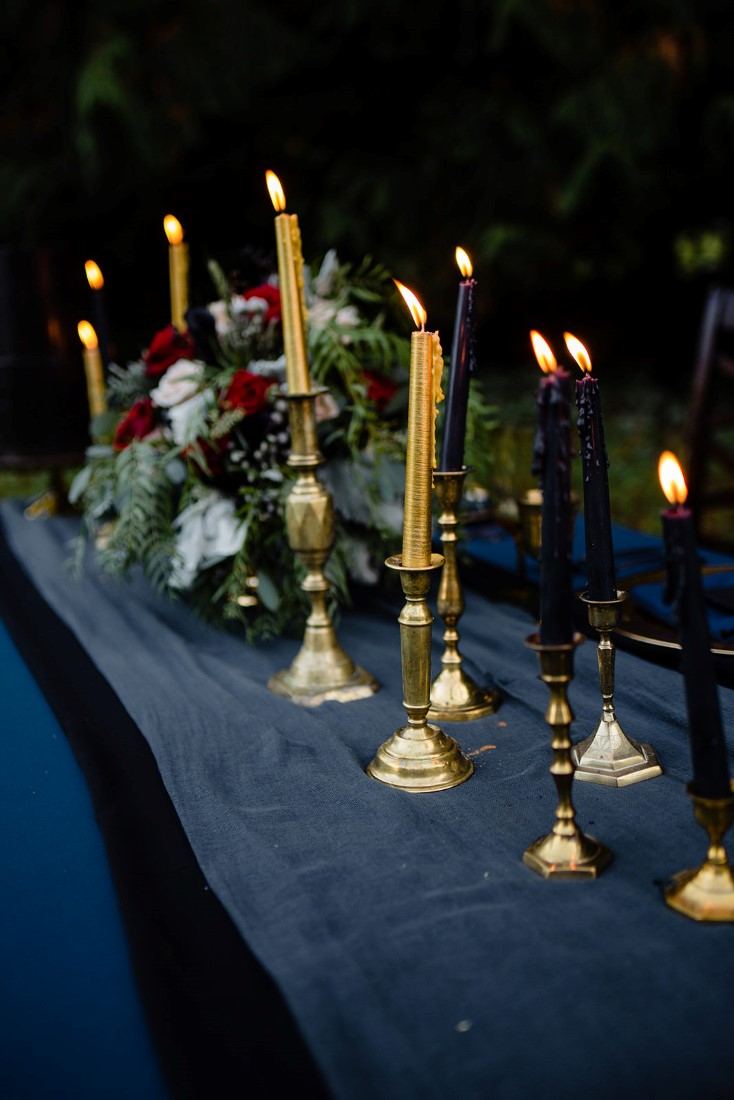 Parade of gold candlesticks on navy linen by Pretty Things Rentals Vancouver