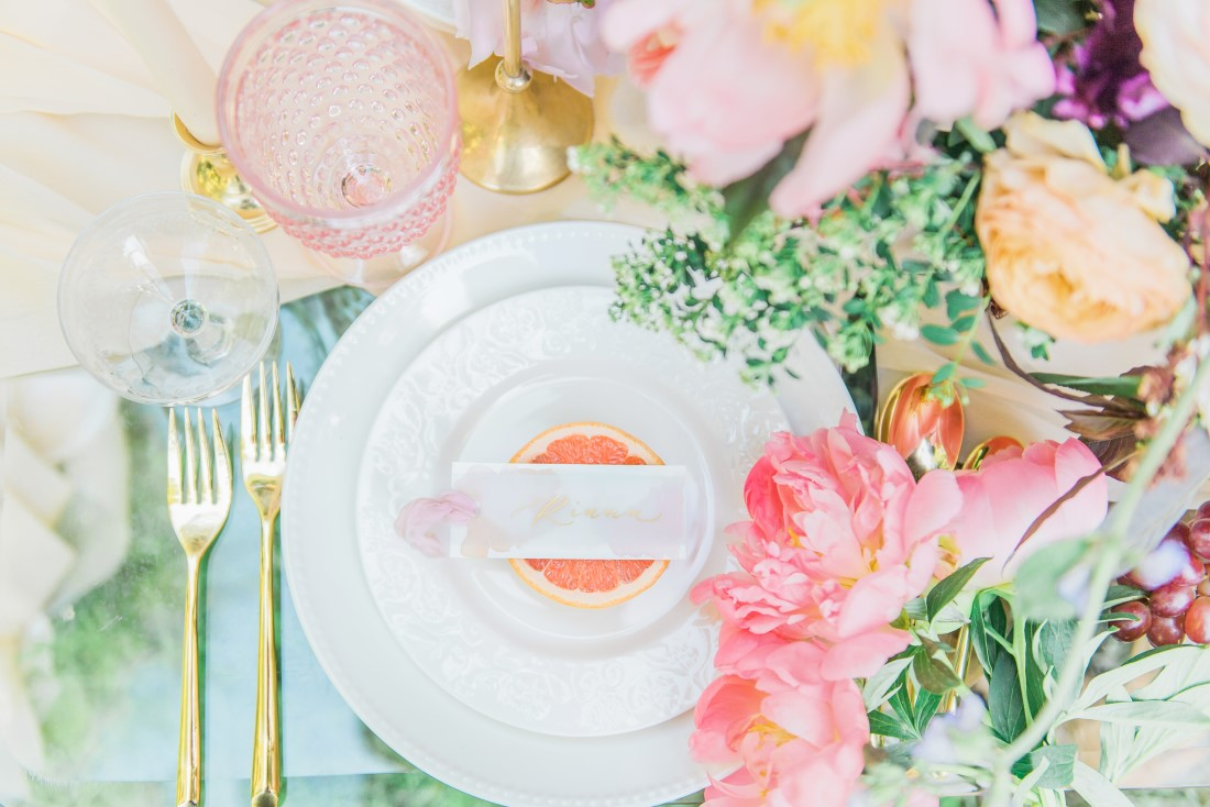 Wedding Reception table with white stacked plates, blush pink peonies, gold cutlery by Ellssi Design and Rentals Vancouver