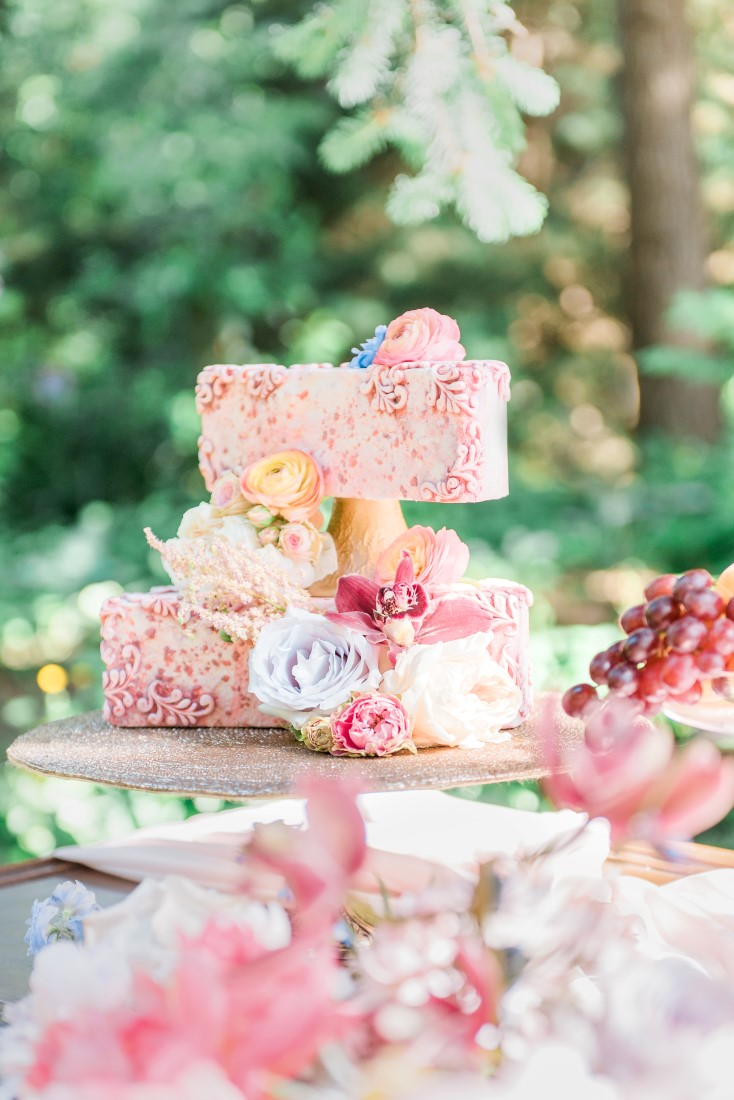 Blush pink wedding cake on gold cake stand by Capital City Cakes Vancouver
