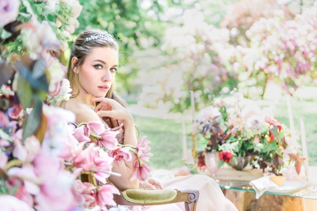 Garden of Eden Bride surrounded by lush flowers in garden