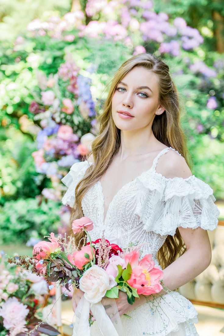 Garden of Eden bride in white gown featuring lace layered sleeves
