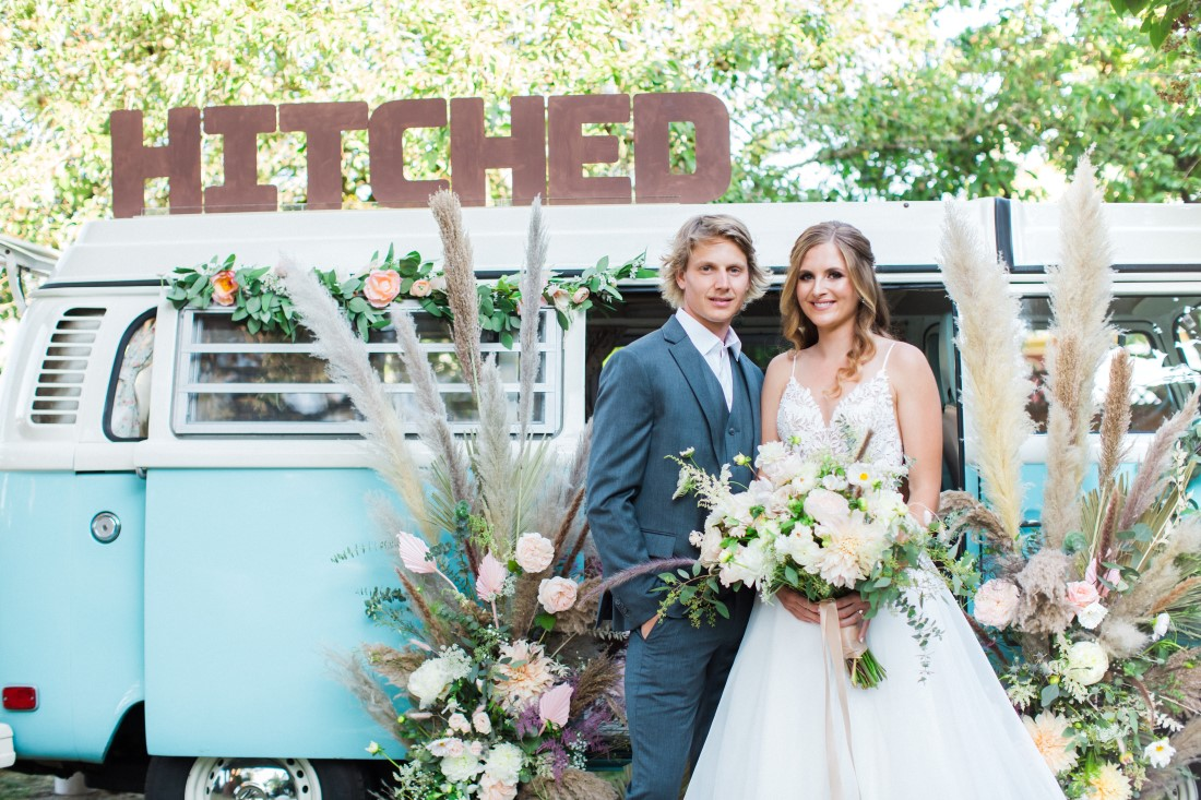Volkswagon Photobus Elopement newlyweds with Hitched sign in Vancouver