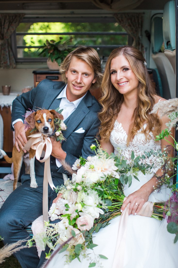 Bride and groom with dog and white bridal bouquet