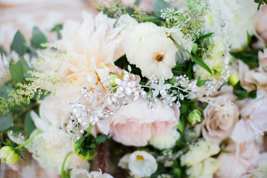 White and blush pink floral arrangement with Luxia Jewelry hairpiece Vancouver