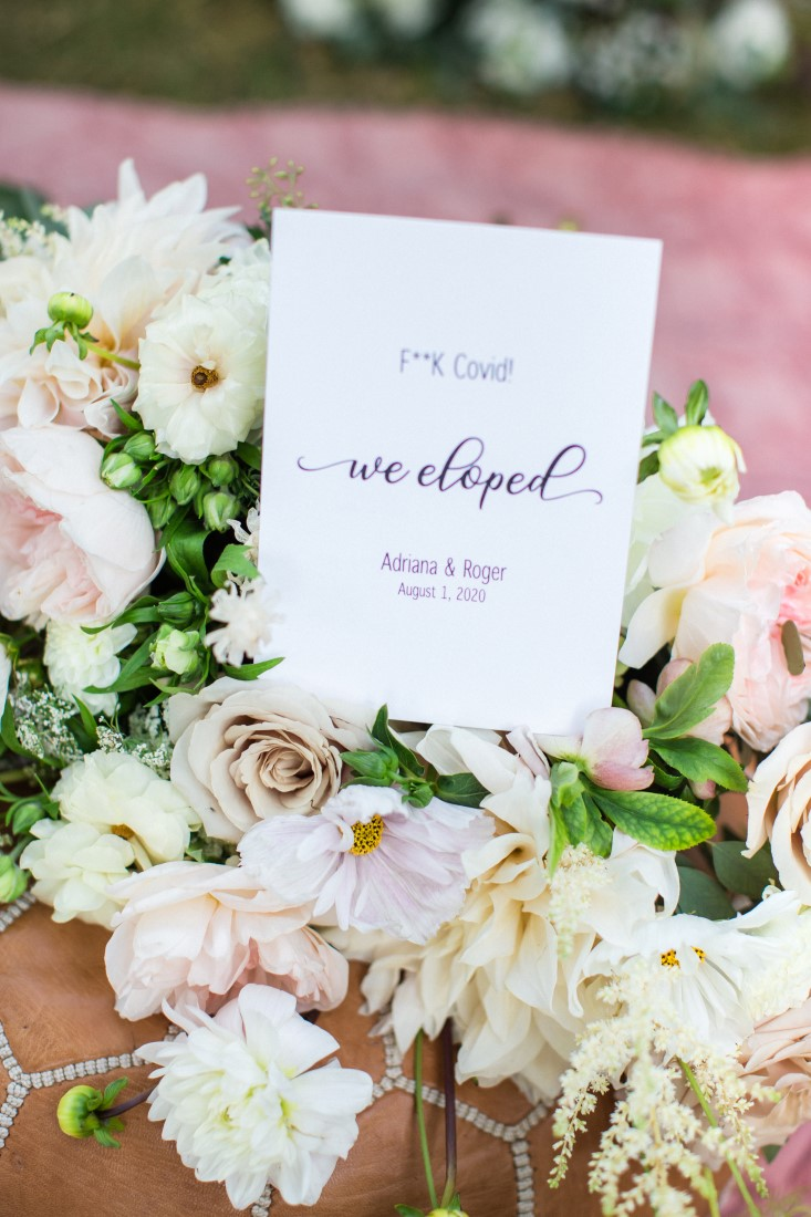 We eloped sign in floral arrangement by Vancouver Flowers