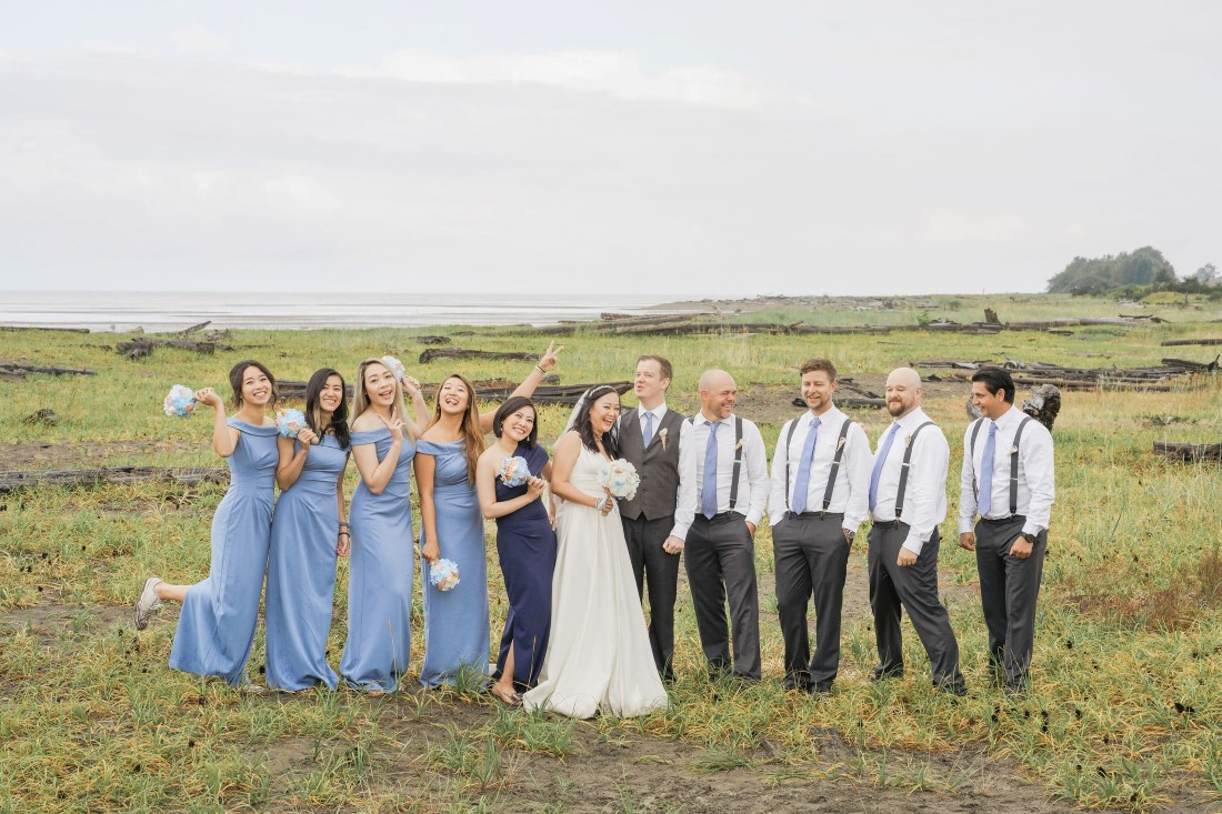 Wedding Party wearing blue along Iona Beach in Vancouver