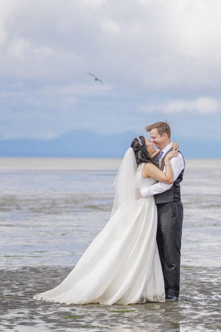 Newlyweds on Iona Beach Vancouver waterside