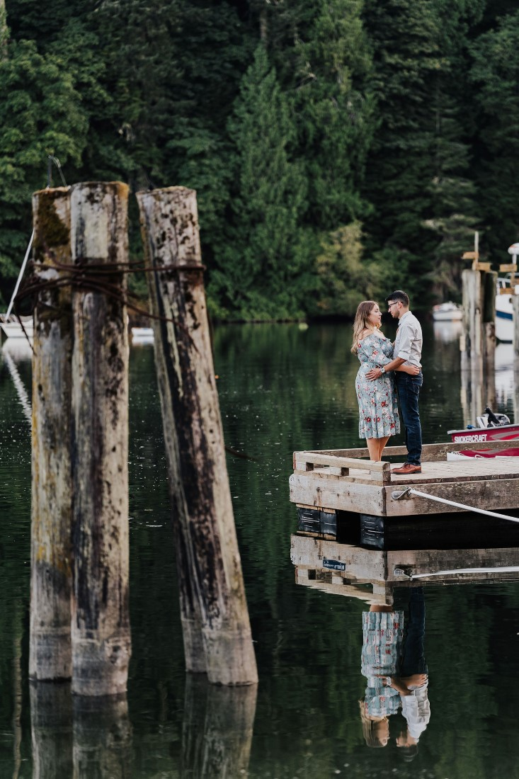 Romantic Couple embrace at the end of a pier on Vancouver Island