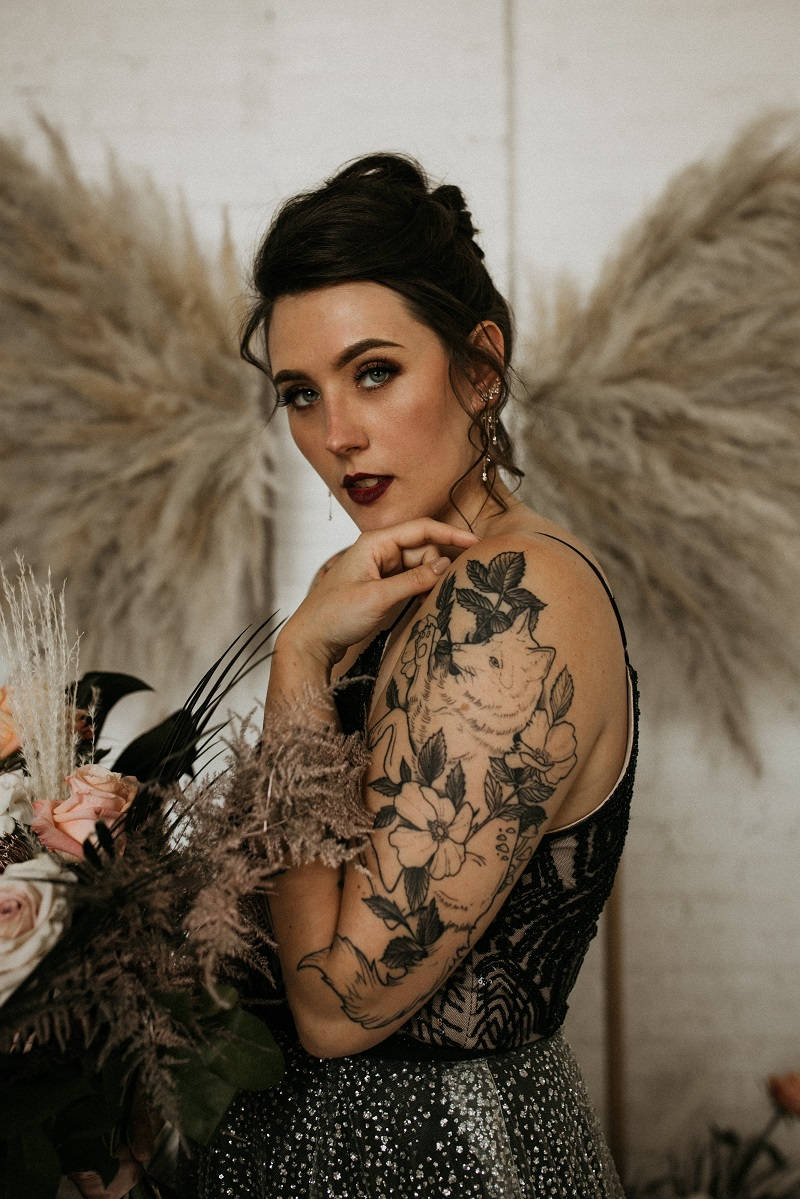 Bride with tattooed arms by Secret Waters Photography