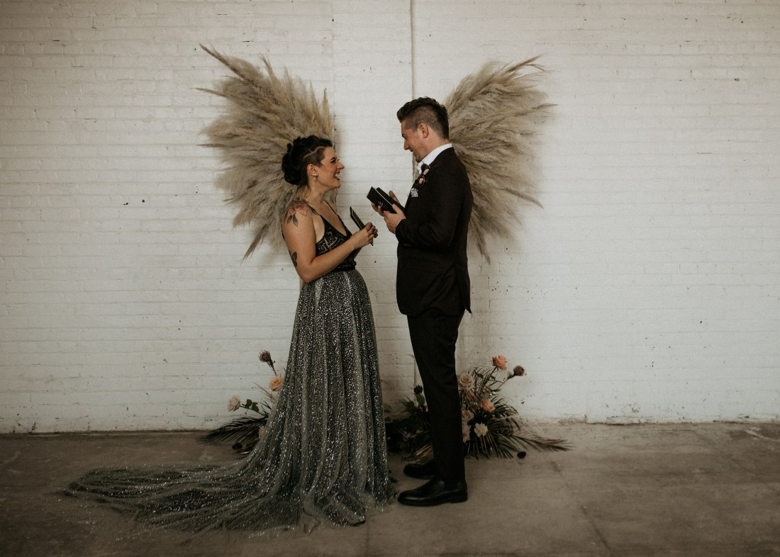 Sweet and Sexy Industrial Glam newlyweds with pampas grass wings