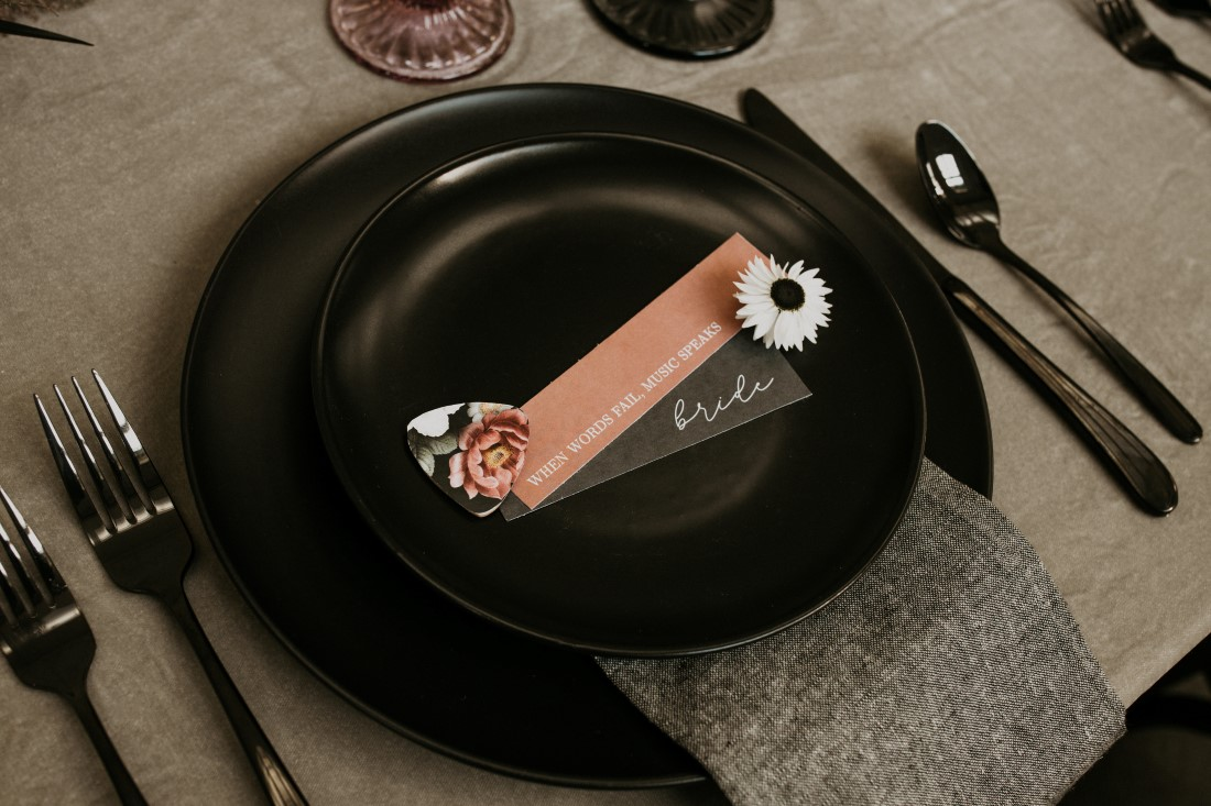 Black plate with giveaway for wedding reception