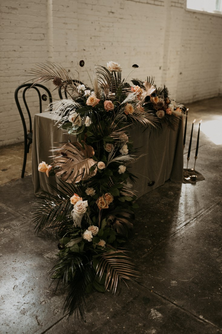 Peach White and Black Floral cascades off edge of reception head table by Bespoke Blossoms