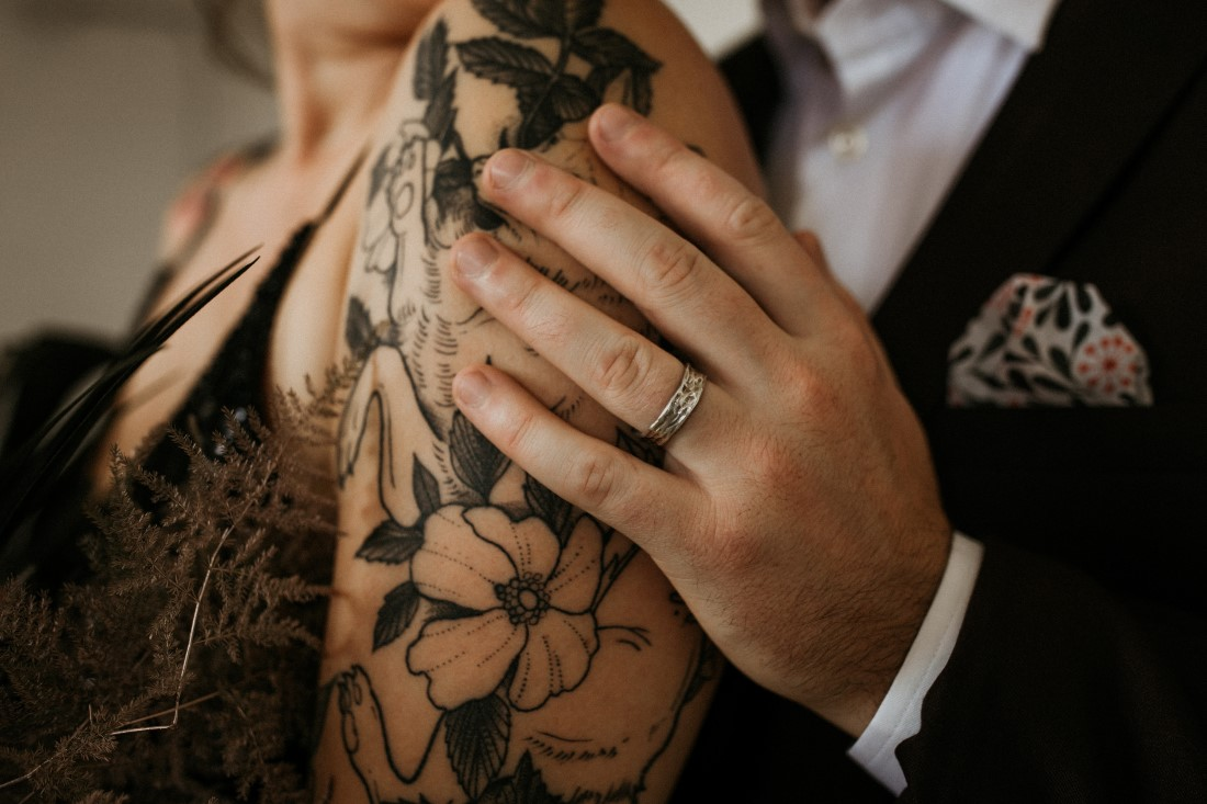 Industrial Chic bride with tattoos on her arm and ring by Emma Glover