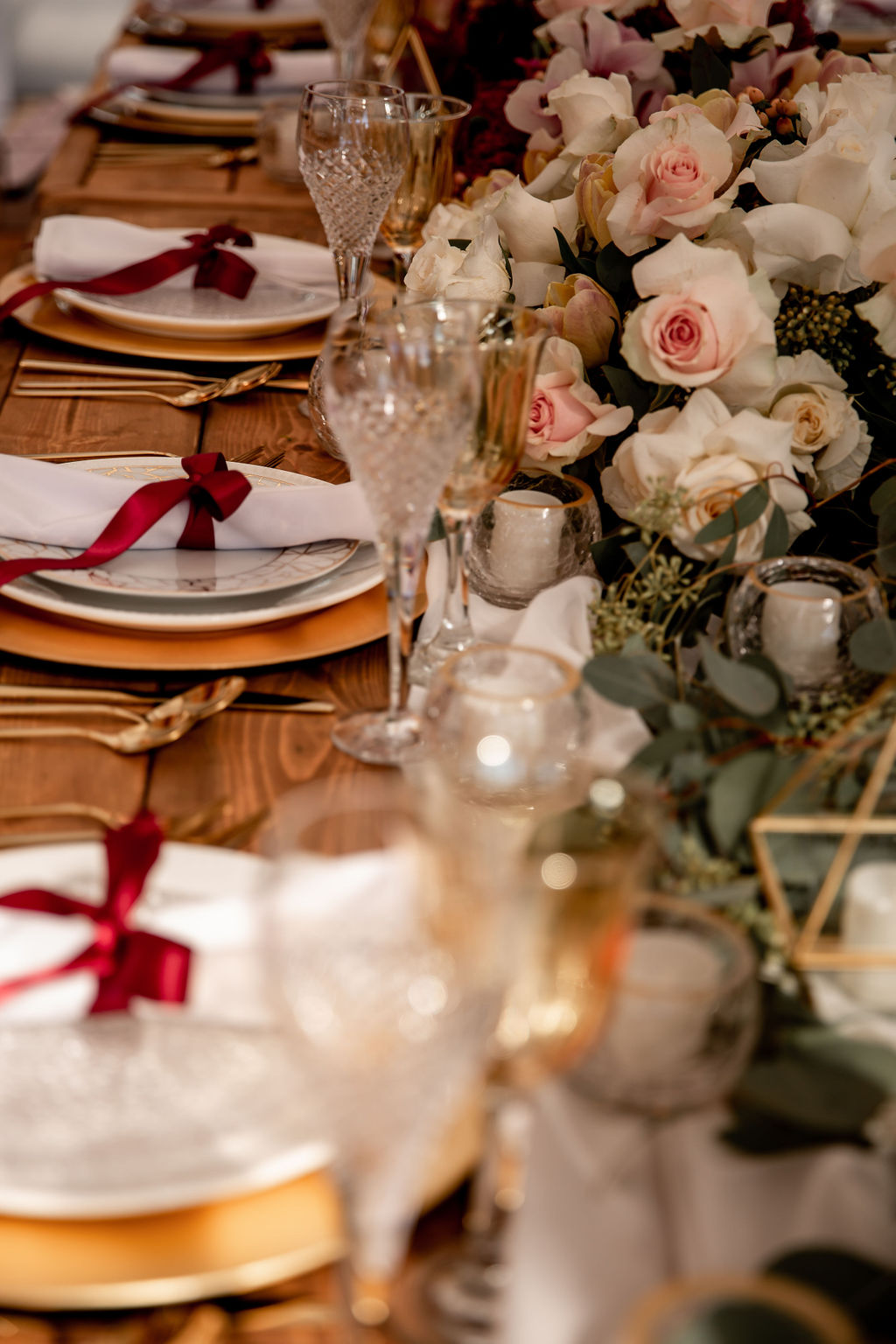 Gold and white plates with burgundy  napkins along pink orchids by Ellssi Designs Vancouver