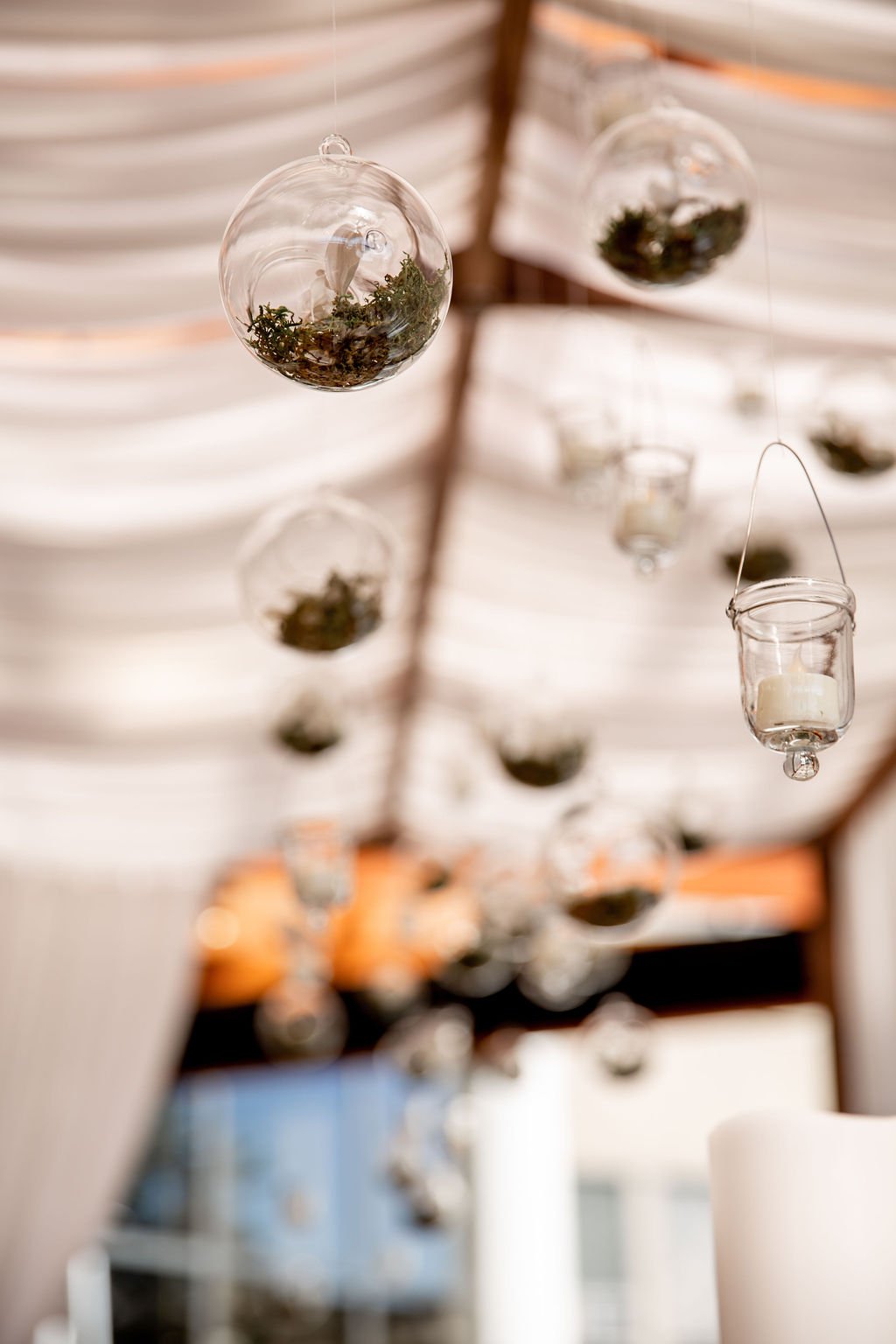 Glass bubble float above wedding table at Pacific Gateway Hotel Vancouver