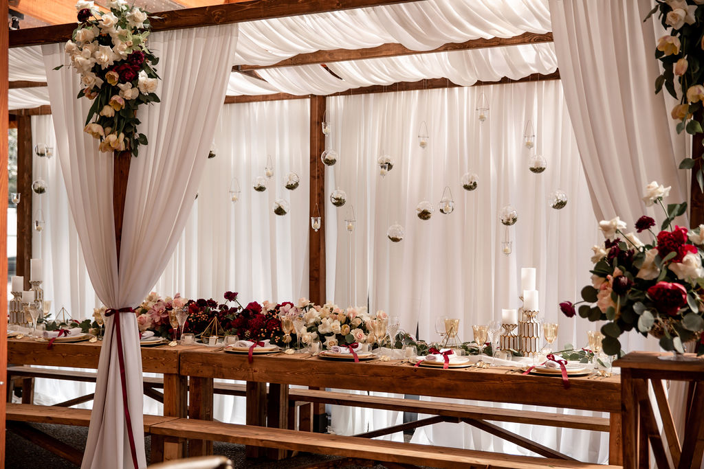 Trestle Table with sheer curtains and glass bubbles by Ellssi Designs Vancouver
